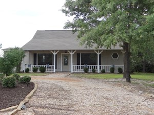 GATED HOME IN HOLLY LAKE RANCH TEXAS FOR SALE