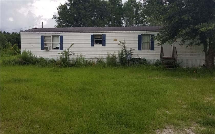 Land with Mobile Home in Lee, FL Priced to Sell