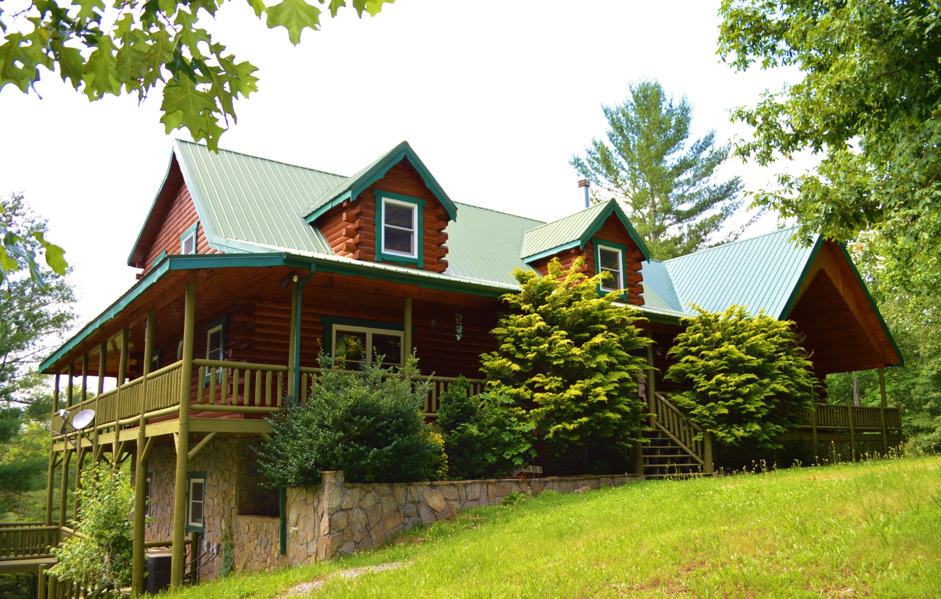 Log Home with 5 Bedrooms and 4 Bathrooms on 12+ Acres.