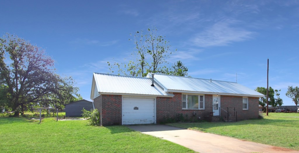 HOME & TWO HUGE SHOPS ON OVER A HALF ACRE FOR SALE IN ERICK