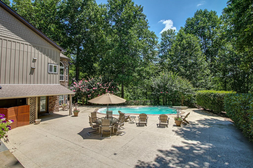 Gorgeous pool among hardwood trees.