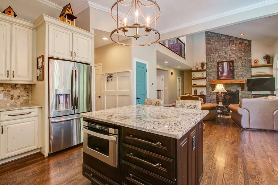 Open, gourmet kitchen.