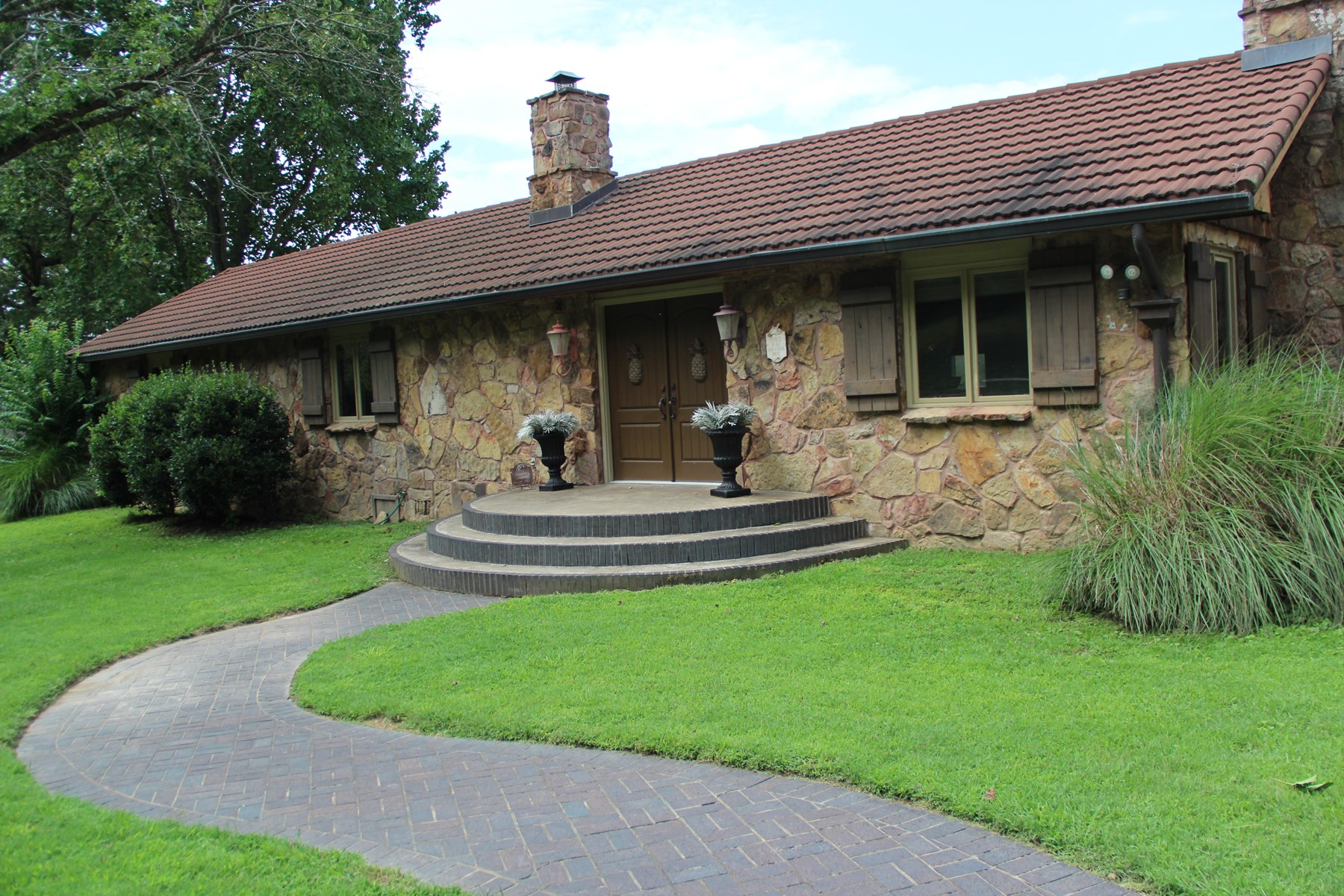 Native stone and lifetime metal shingle roof