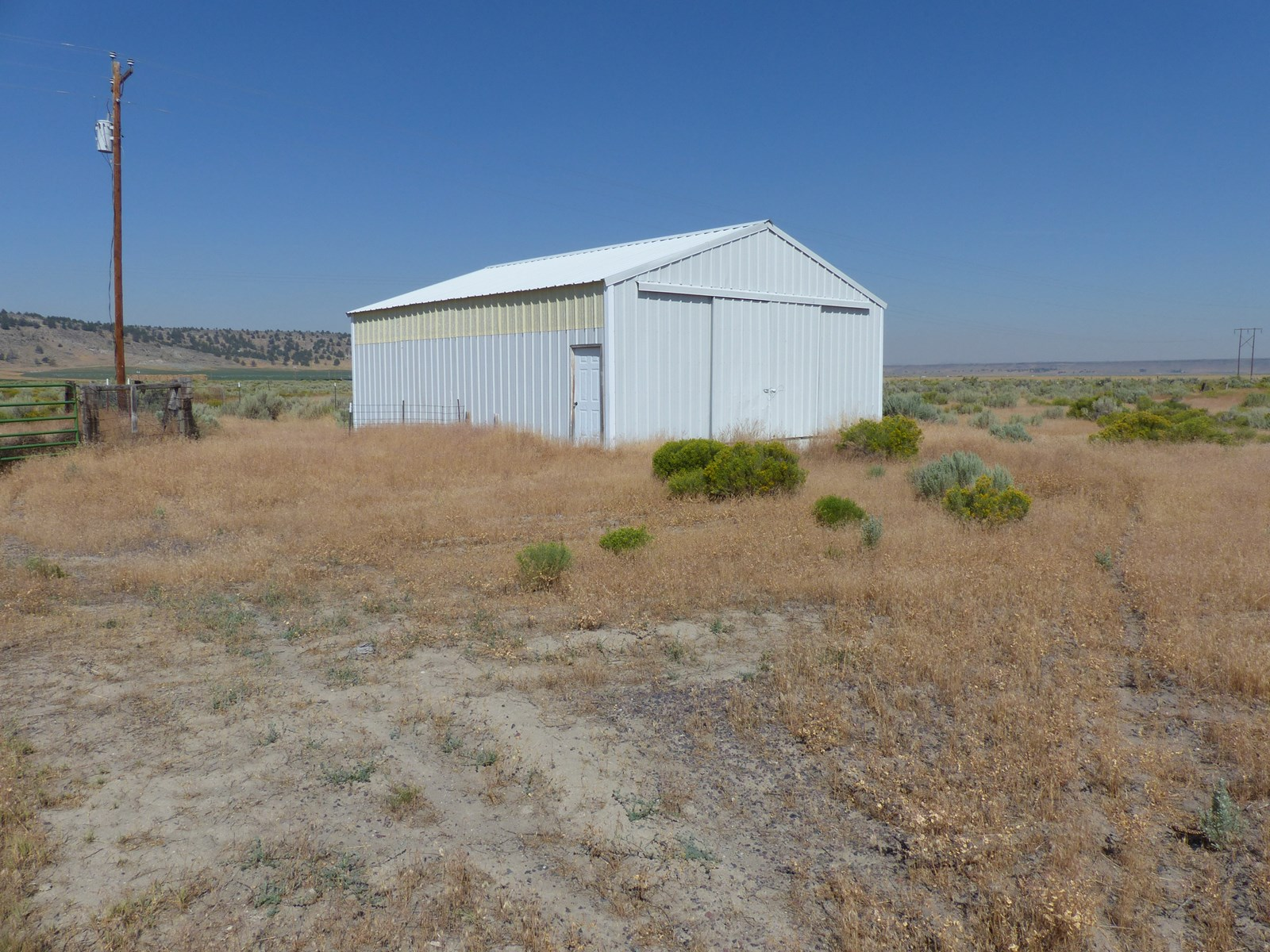 BURNS, OR - 160 ACRES WITH SHOP - FENCED - POWER CLOSE