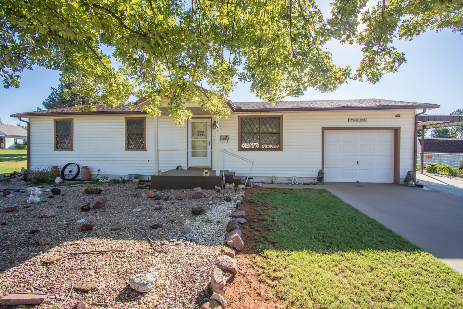 HOME FOR SALE IN ELK CITY ON 3 LOTS LOCATED ON THE CORNER
