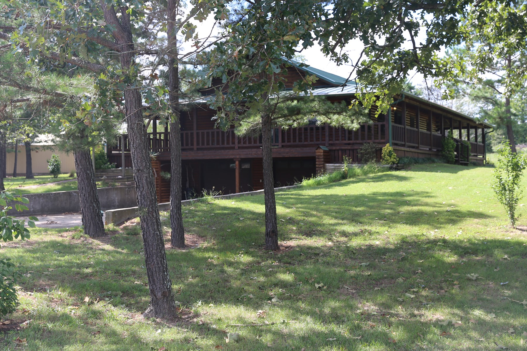 Missouri Ozarks log home with shed for sale in Howell County