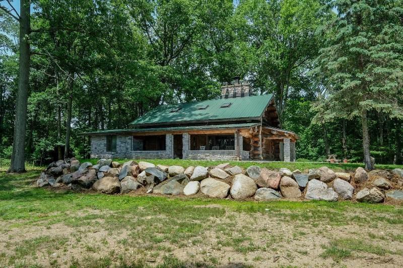 Cedar Lake log home on 124 acres in Marshall, MI