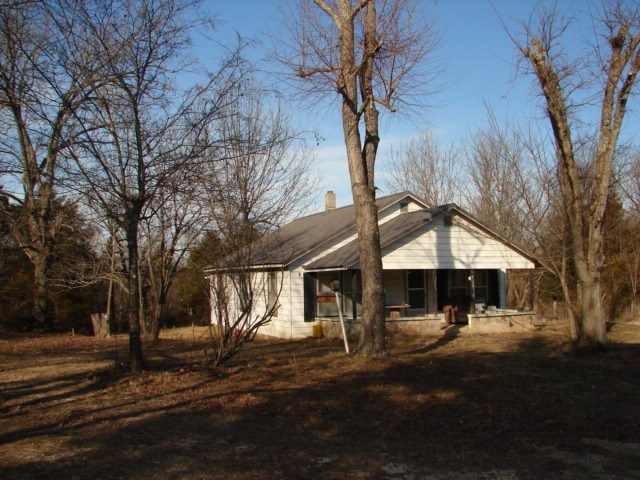 Highway Frontage Land with Older Home and Acreage for Sale
