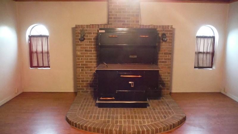 wood cook stove on brick hearth