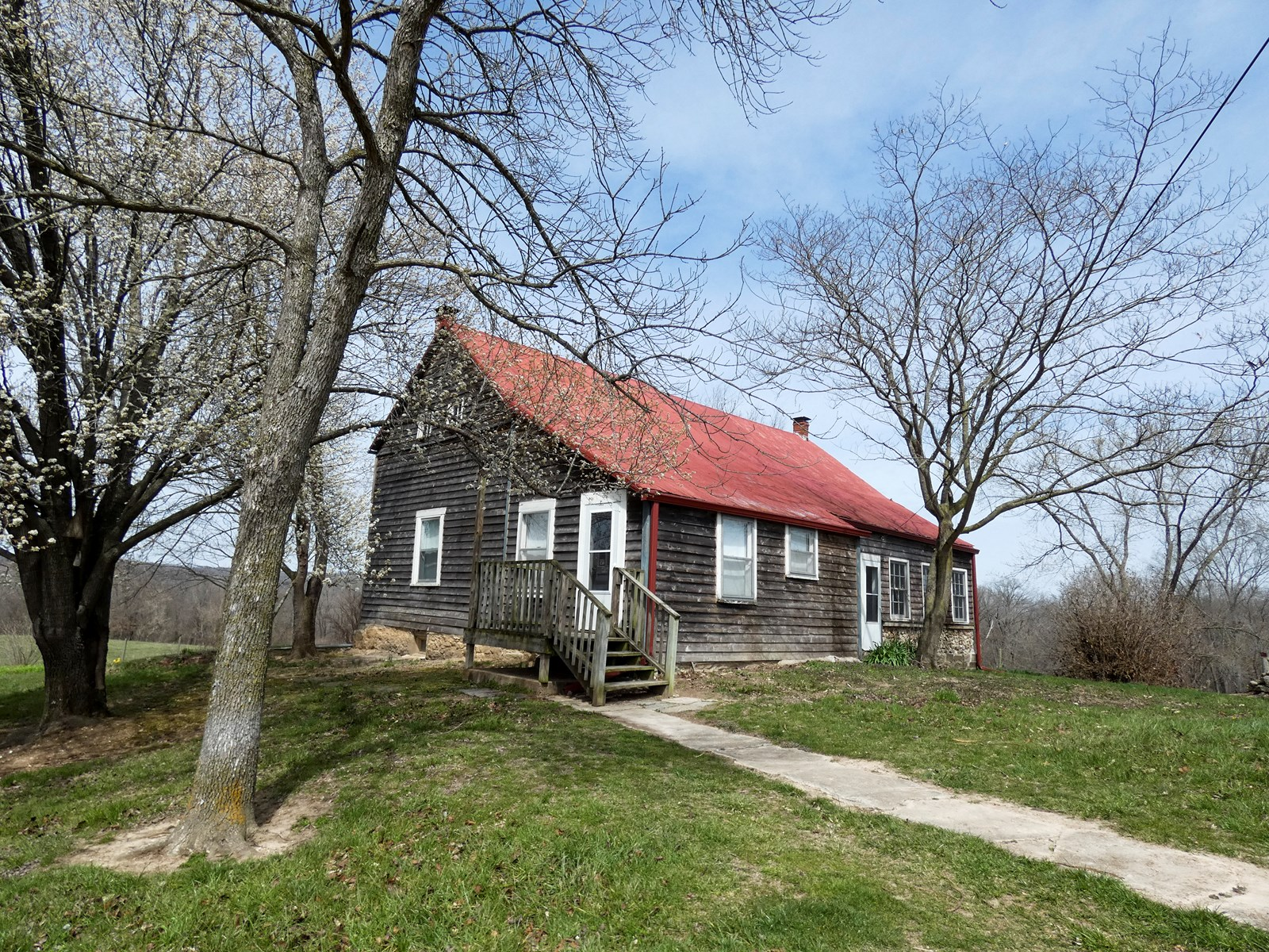 Historic Log Home & Riverfront Acreage For Sale in Hermann