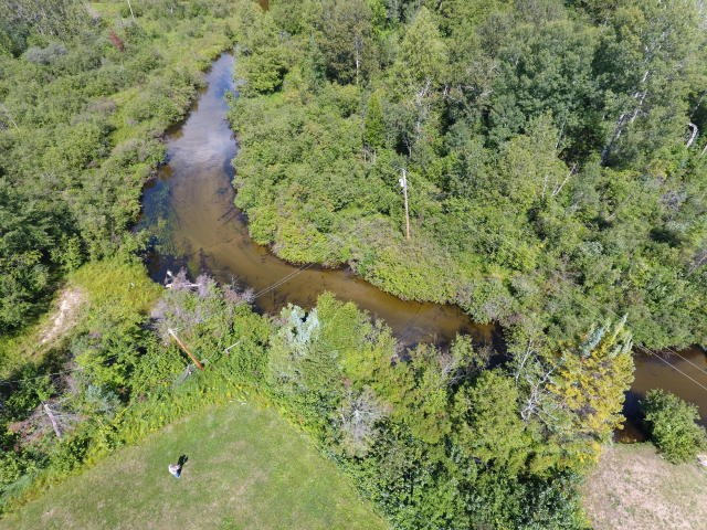 Riverfront Acreage on Thunder Bay River for sale Atlanta MI