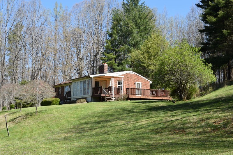 Large Wooded Acreage & Brick Ranch Home for Sale in Floyd VA