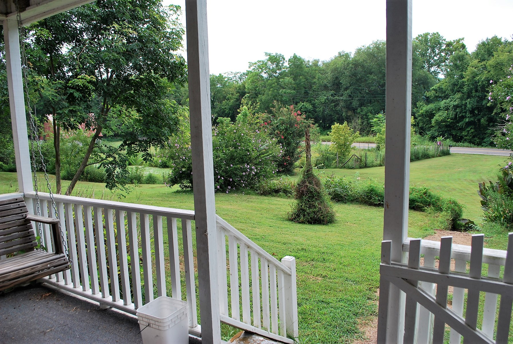 View of pond/ fenced area from front porch