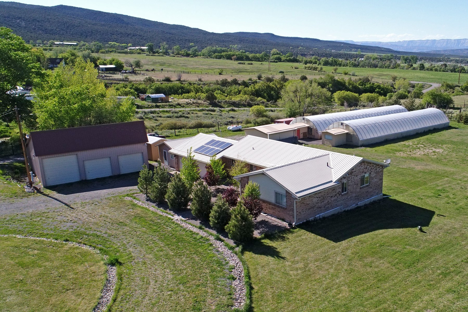 Custom, Energy Efficient Home with Greenhouses, Irrigation,