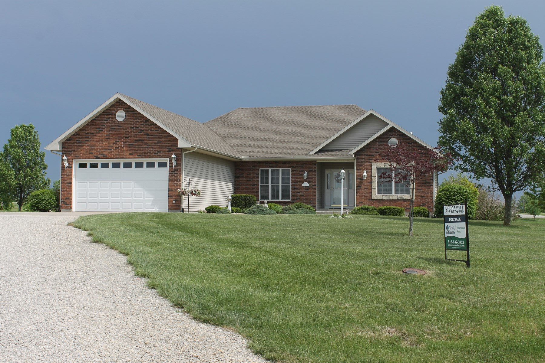 COUNTRY HOME AND ACREAGE FOR SALE IN CAMERON MO
