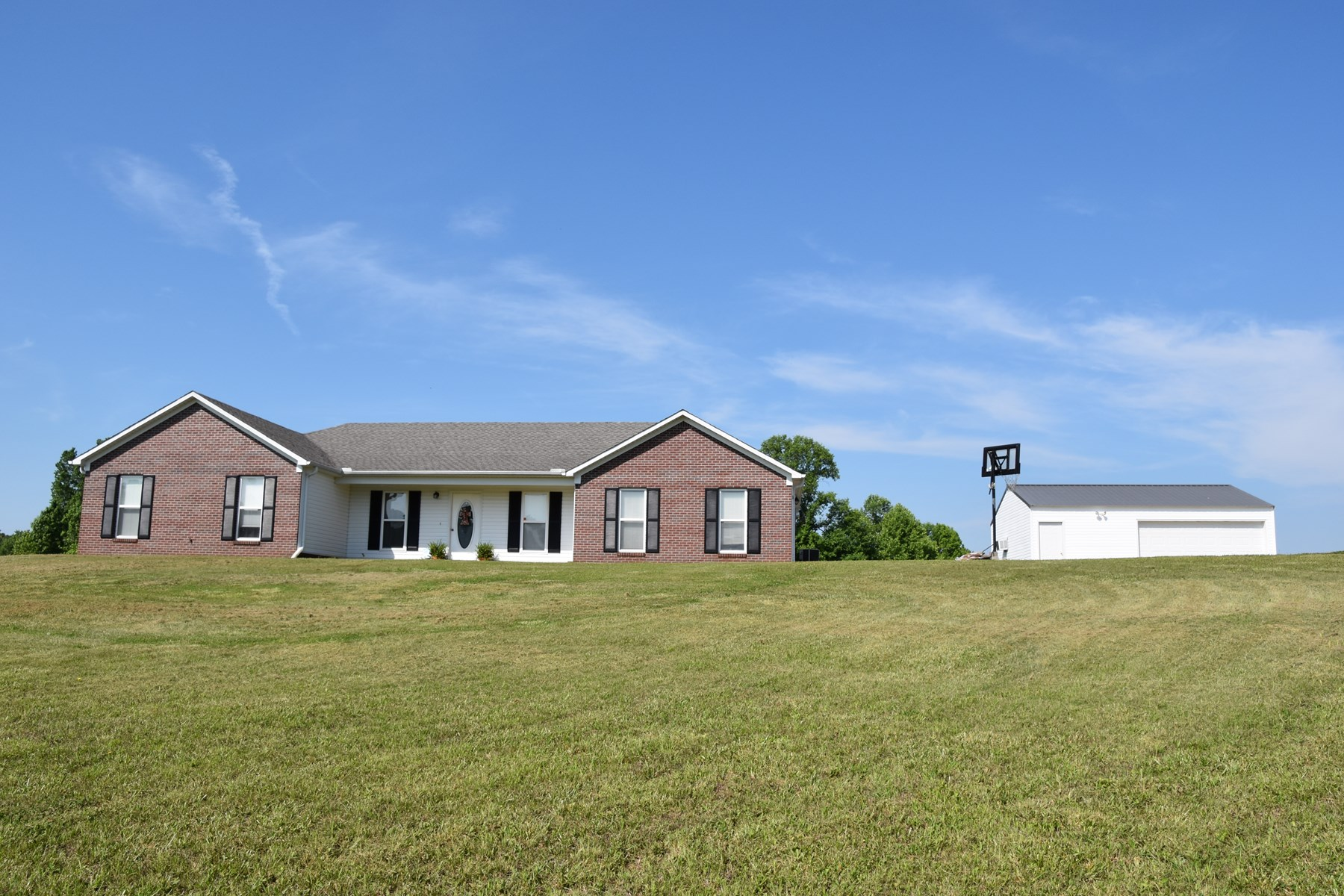 Henderson Co TN home for sale on acreage with Shop & Deck!