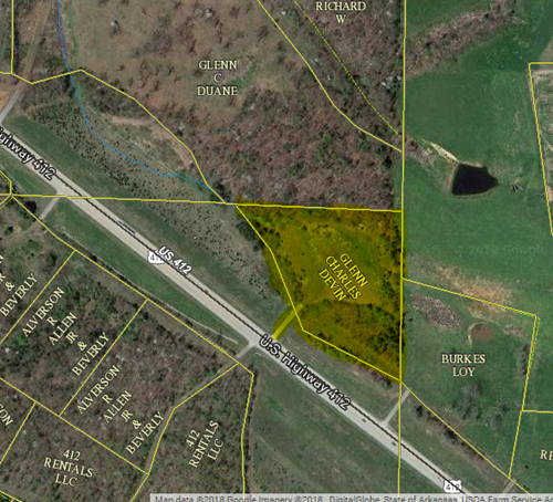 4 Acres of Hwy 412 frontage prime for development.