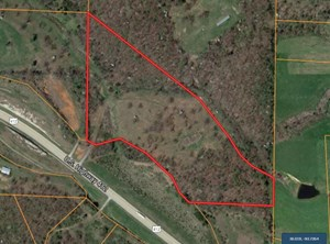 21+/- ACRES OF HWY 412 FRONTAGE PRIME FOR DEVELOPMENT.