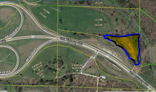 4+/- Acres of Hwy 412 frontage prime for development.