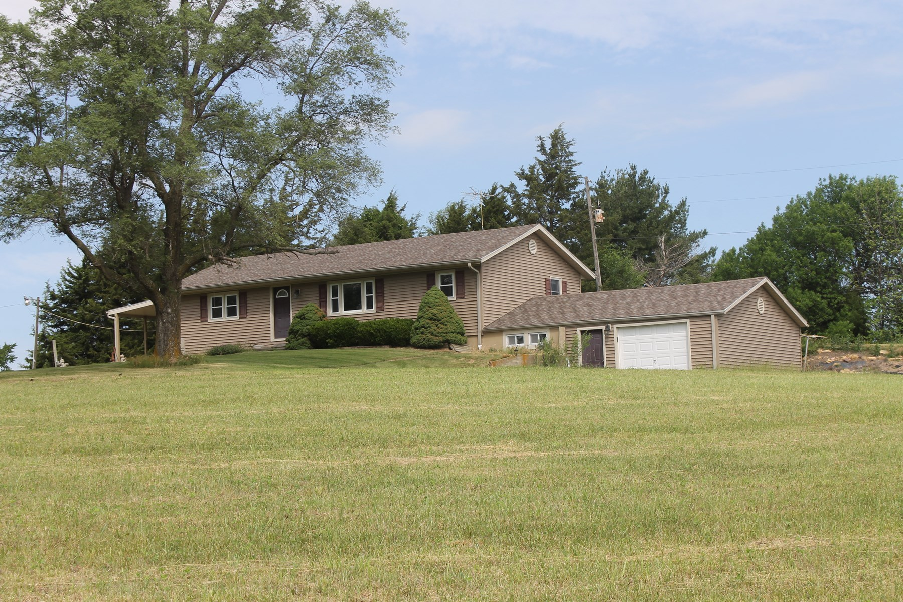 PRICE REDUCTION!  MAYSVILLE MO HOME & ACREAGE FOR SALE