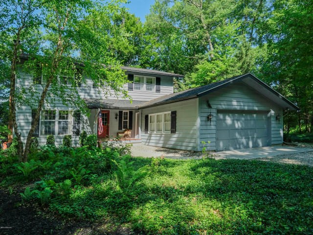 Attractive home with sandy lake frontage on Little Long Lake