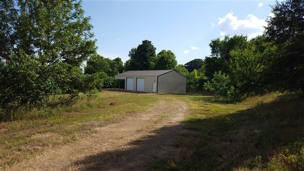 4.21 Acre Home Site & Metal 4Building w/ Living Quarters