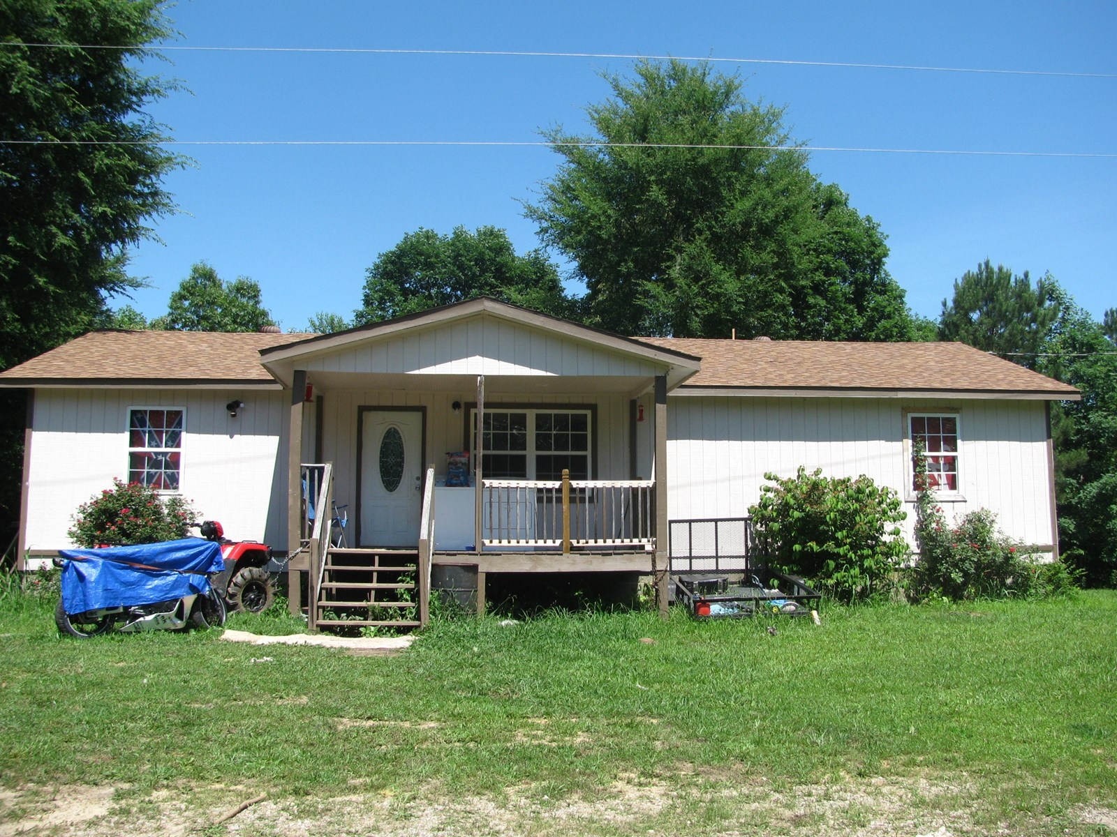 COUNTRY HOME ON 8 ACRES IN ADAMSVILLE, TN FOR SALE
