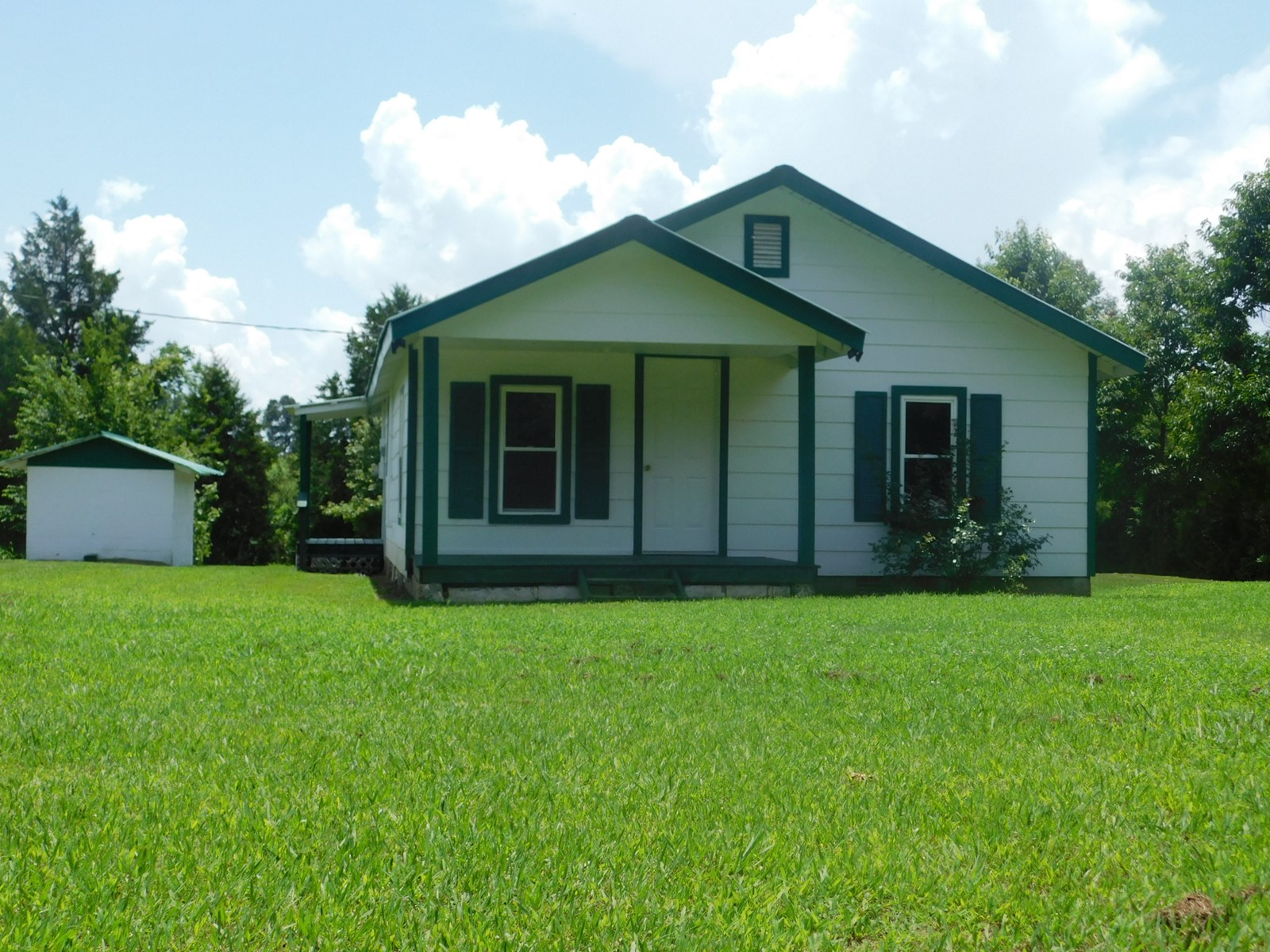 NEWLY REMODELED AFFORDABLE COUNTRY HOME FENCING, FRUIT TREES