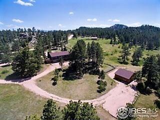 Beautiful mountain home on stunning 7.79 acres!