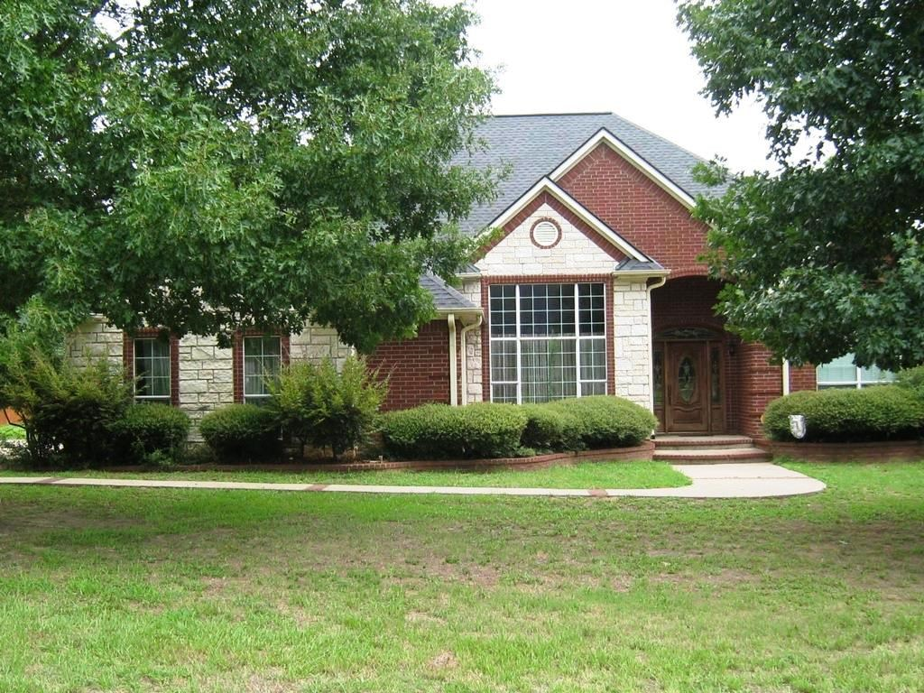 BEAUTIFUL CUSTOM HOME IN HOMES ONLY SUBDIVISION