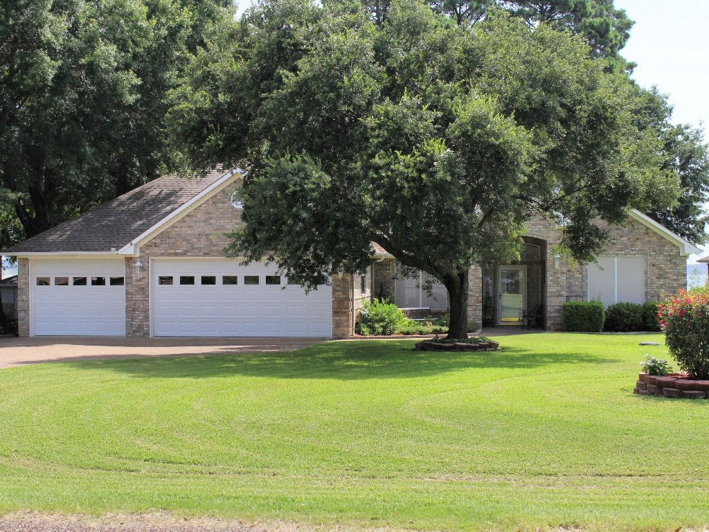 LAKE PALESTINE WATERFRONT HOME FOR SALE W/ BOATHOUSE