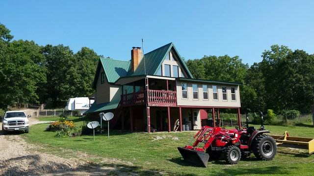 Home, Outbuildings & 100 Acres of Recreation!