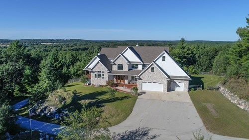 Large Upscale Home for sale w/ Acreage in Waupaca, WI
