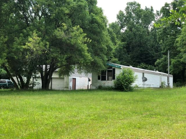 Property with acreage in a great location