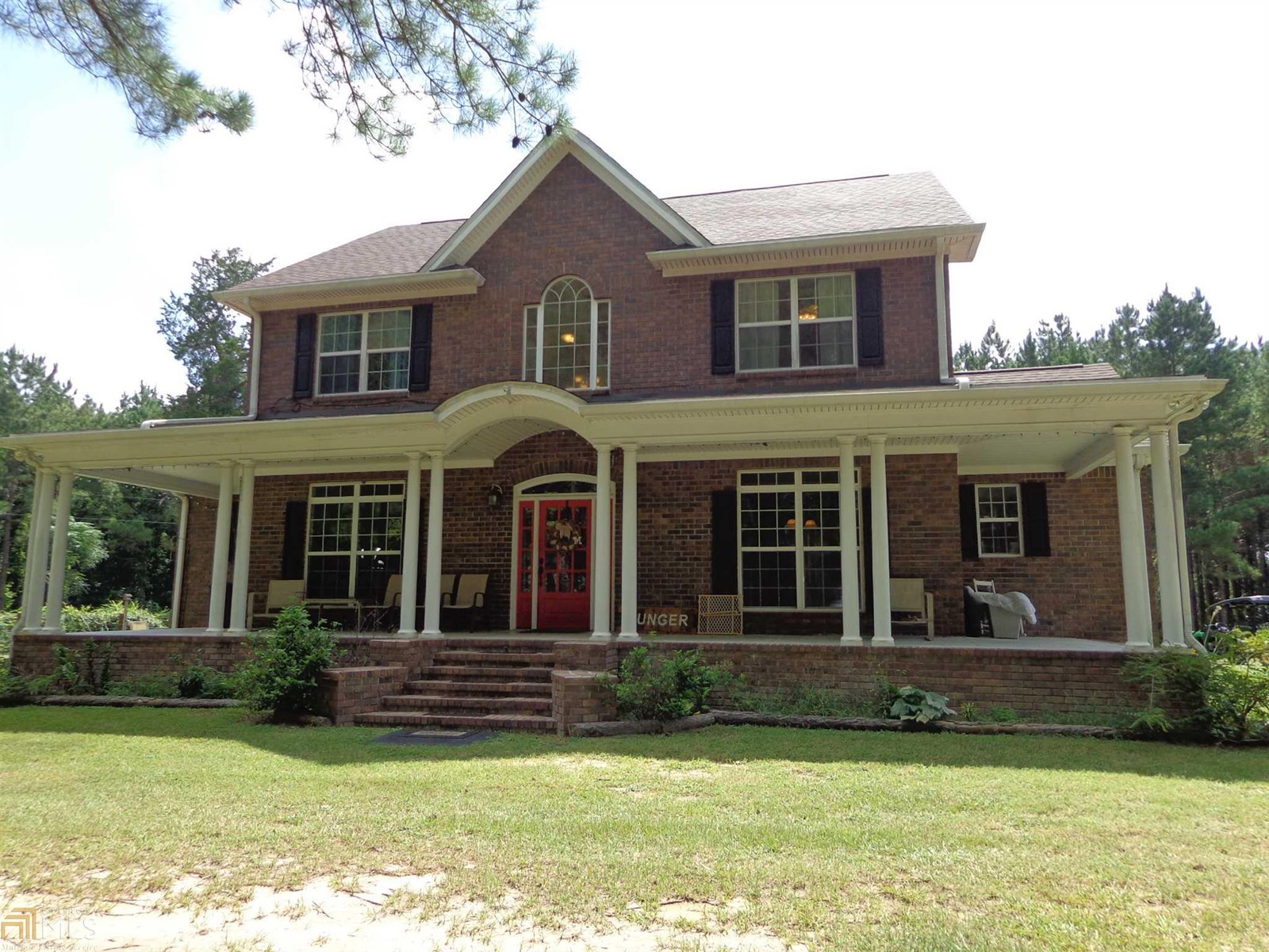 5 BR & 3.5 BA Nestled on Hill in 7+ Acres of Wooded Privacy