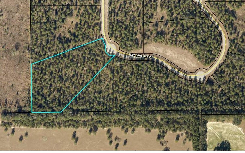 Beautiful wooded 5 acre lot on paved road