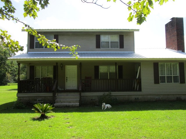 Large home with land and additional rooms in Altha FL