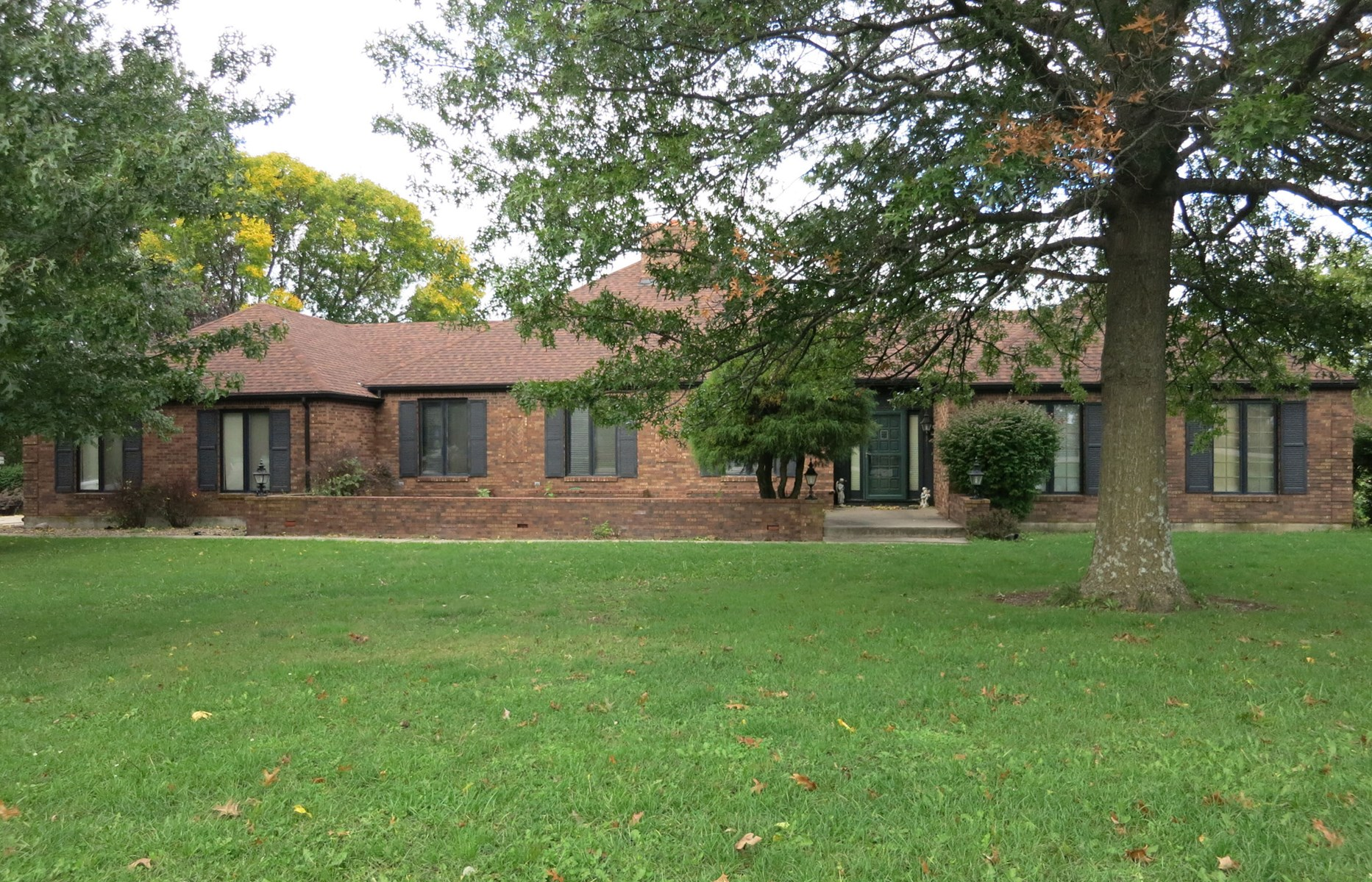 Brick Home with In-Ground Pool on Golf Course
