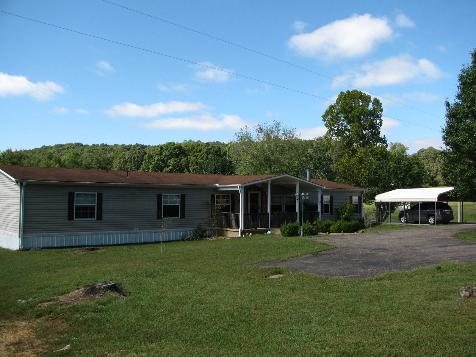 COUNTRY HOME FOR SALE IN TN, STORM SHELTER, POOL, WELL, ACRE