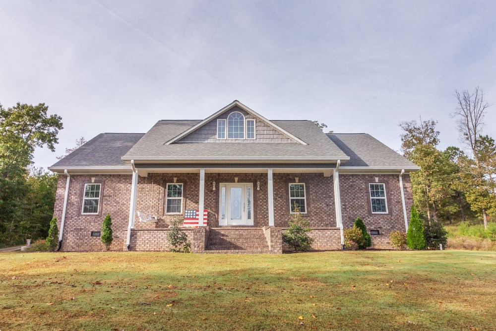 Beautiful Custom Brick on over 7 Acres in Selmer, TN