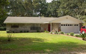 A WELL KEPT AND MAINTAINED BRICK HOME