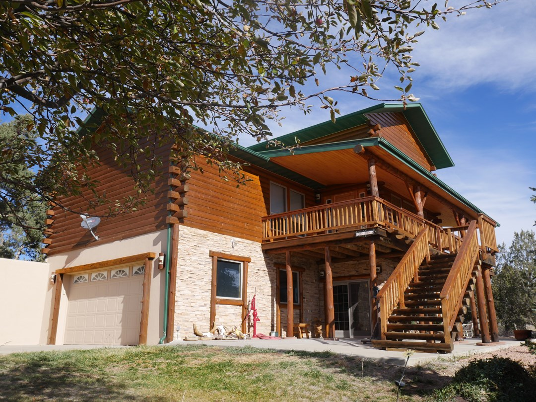 Colorado Log Home For Sale on 35 acres with Mountain Views