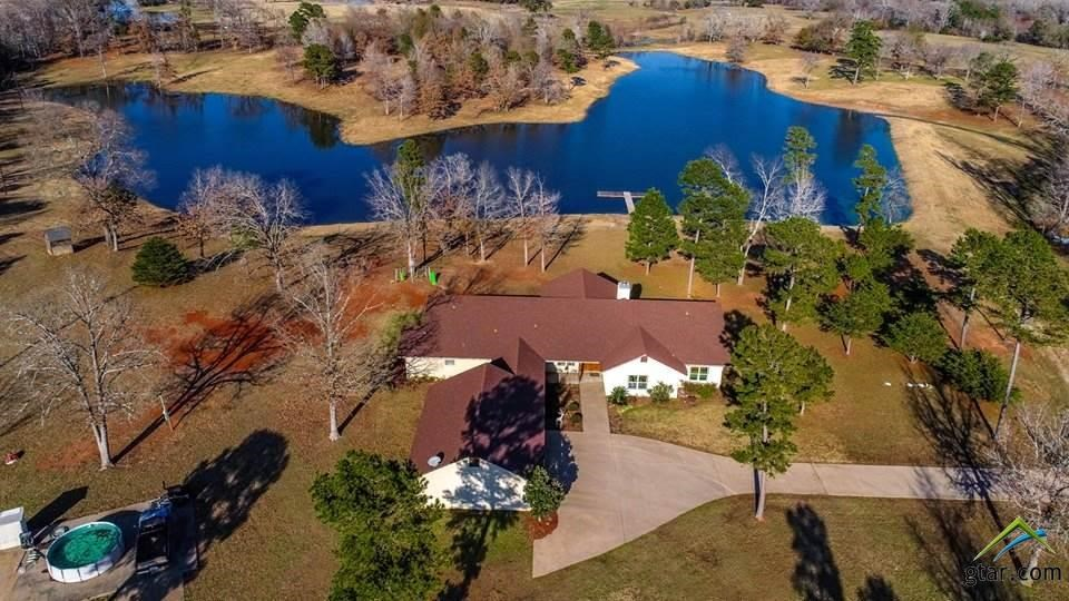 EAST TEXAS COUNTRY HOME + PRIVATE  LAKE + 29.5 ACRES