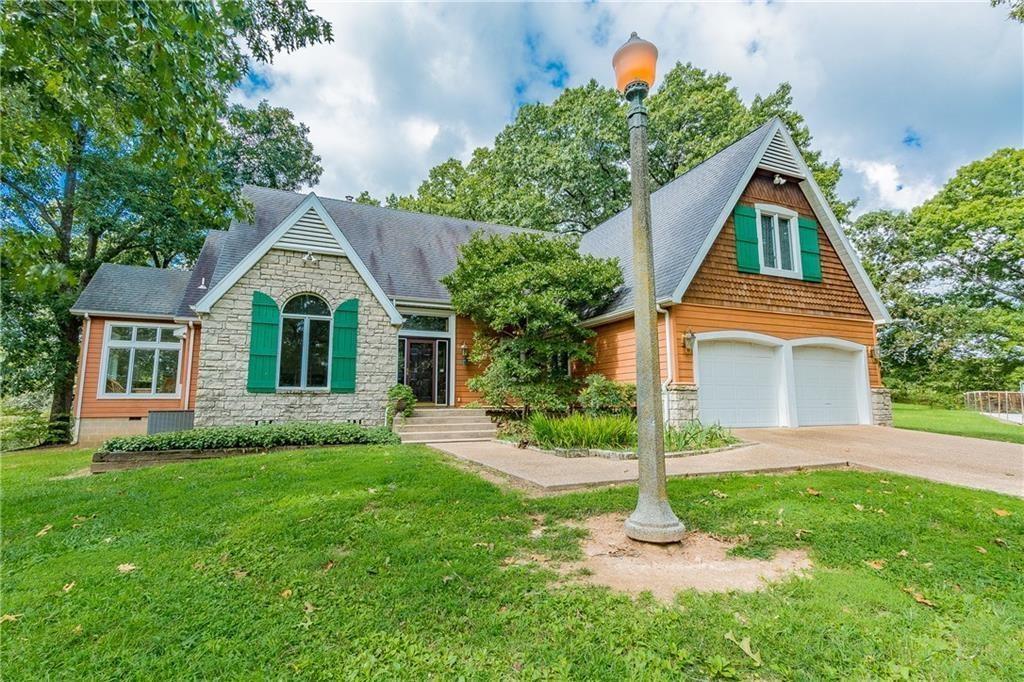 Pea Ridge Estate Home with acreage & shop for sale.