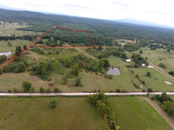 40.2 Acre Homesite with Mountain View Adjoining Poteau River