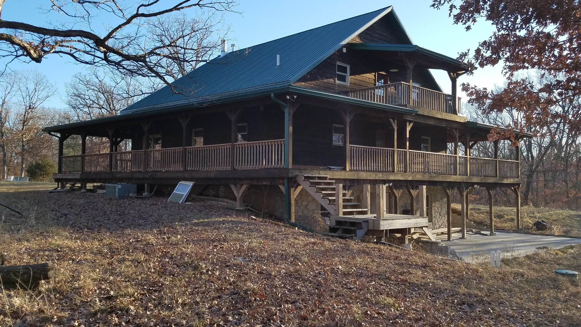 Hunting land for sale with large home, pole barn, & cabin