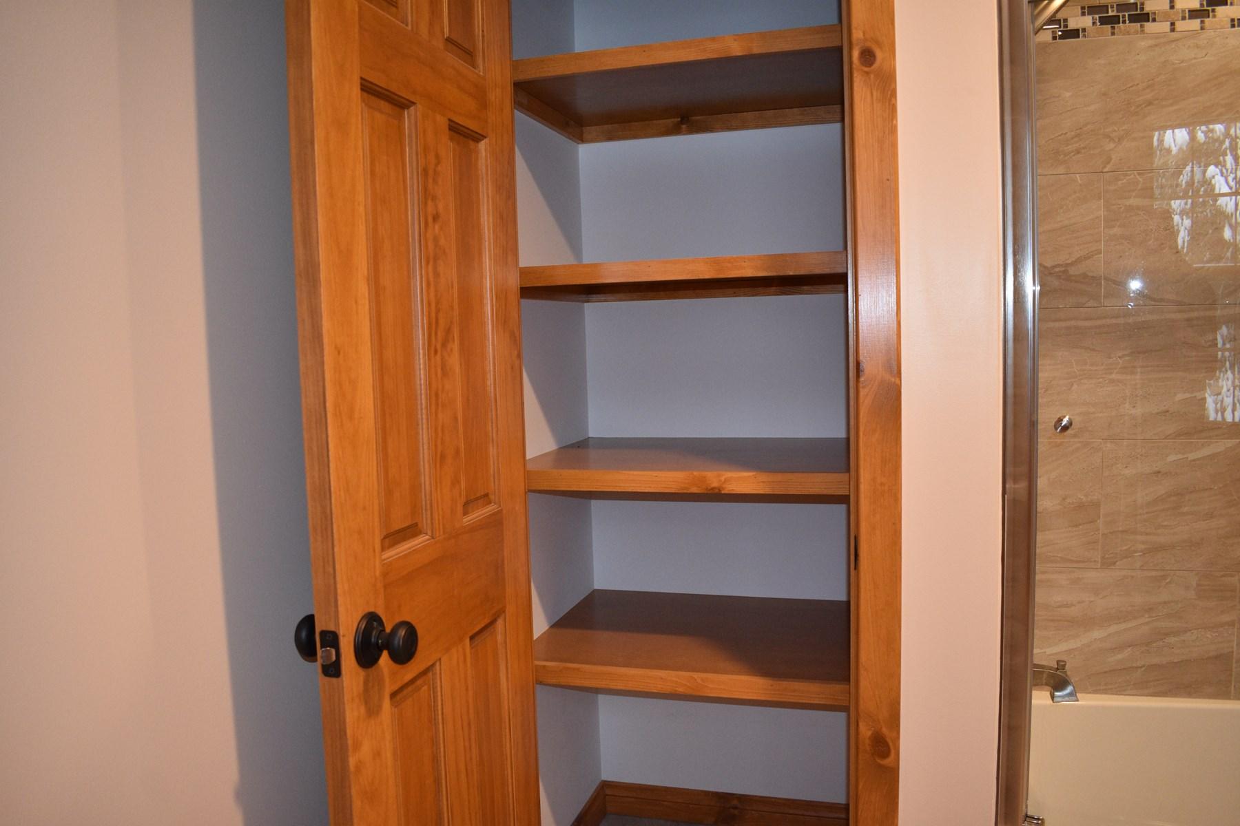 Master Bath Closet w.custom Shelves