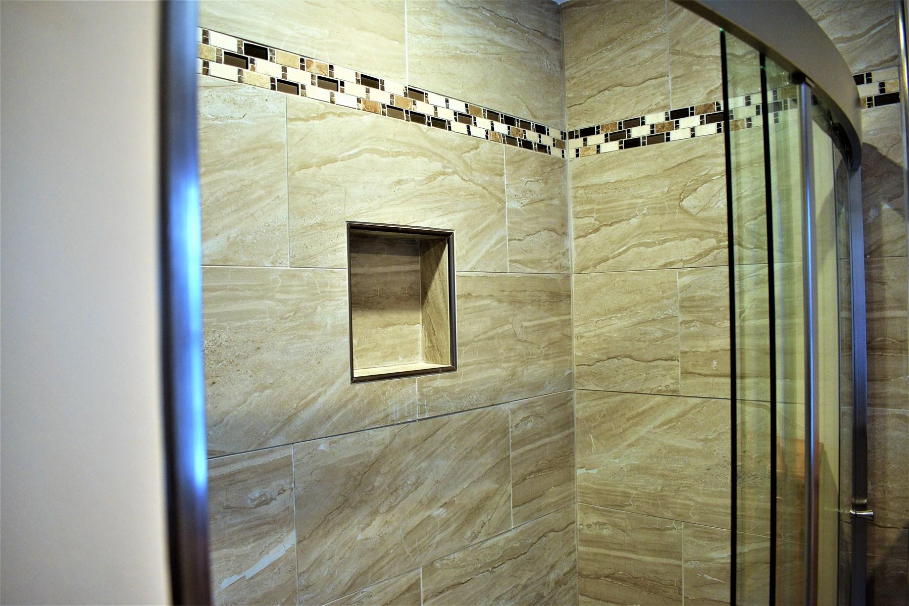 Master Shower Tiled walls