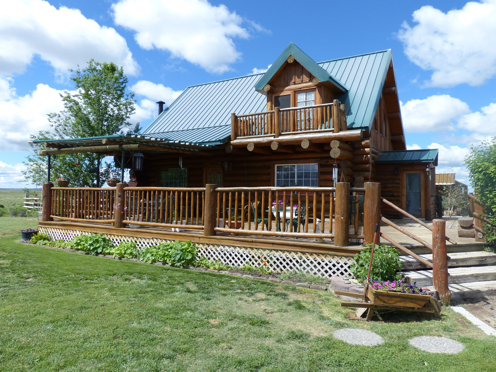 CUSTOM BUILT LOG HOME ON 160 ACRES PLUS SECOND RESIDENCE