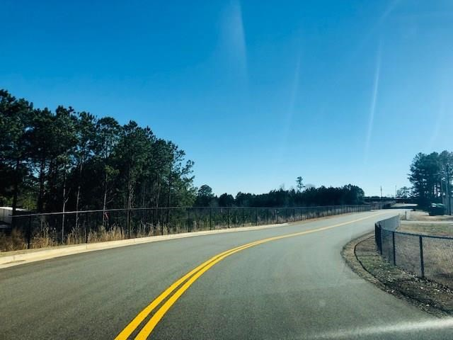 11.56 Acre tract zoned General Commercial in Cherokee Co, GA